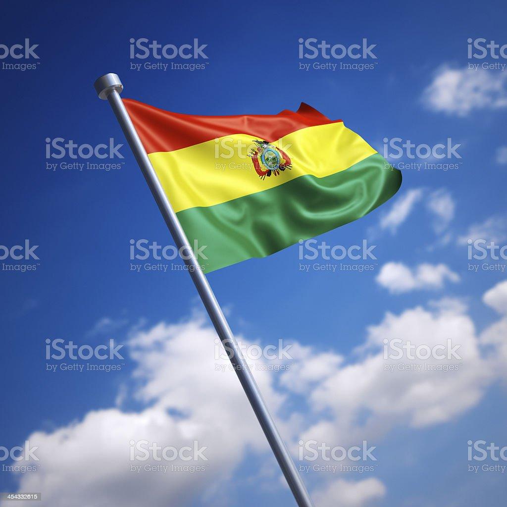 Flag of Bolivia against blue sky stock photo