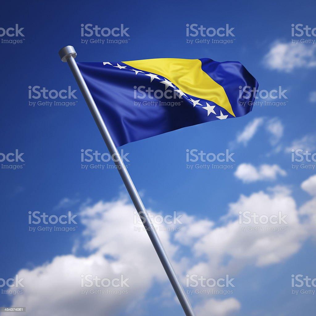 Flag of Bosnia and Herzegovina against blue sky stock photo