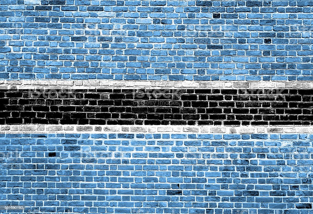Flag of Botswana painted on brick wall, background texture stock photo