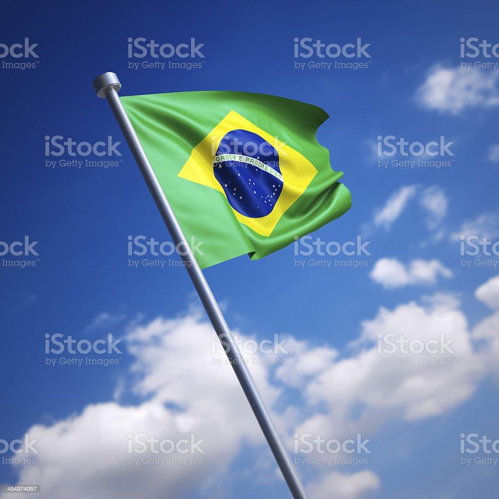 Flag of Brazil against blue sky stock photo