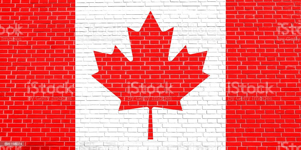 Flag of Canada on brick wall texture background stock photo