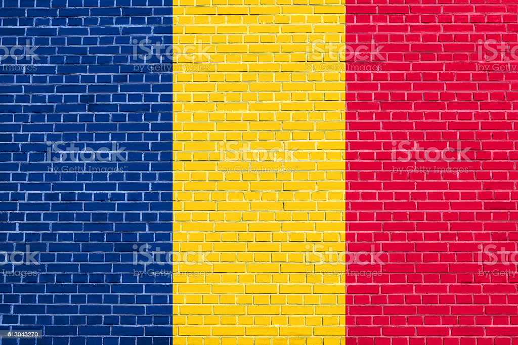 Flag of Chad on brick wall texture background stock photo