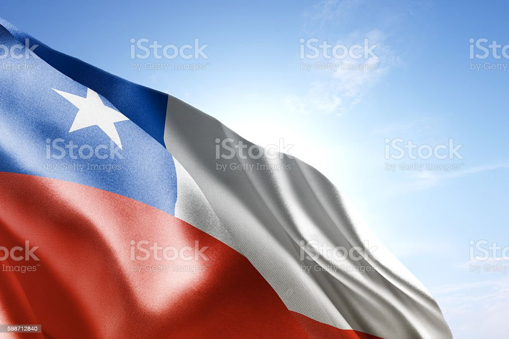 Flag of Chile waving in the wind stock photo