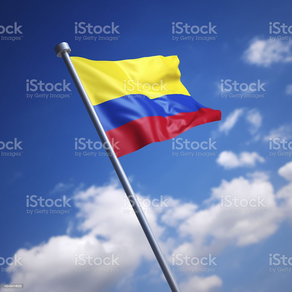 Flag of Colombia against blue sky stock photo