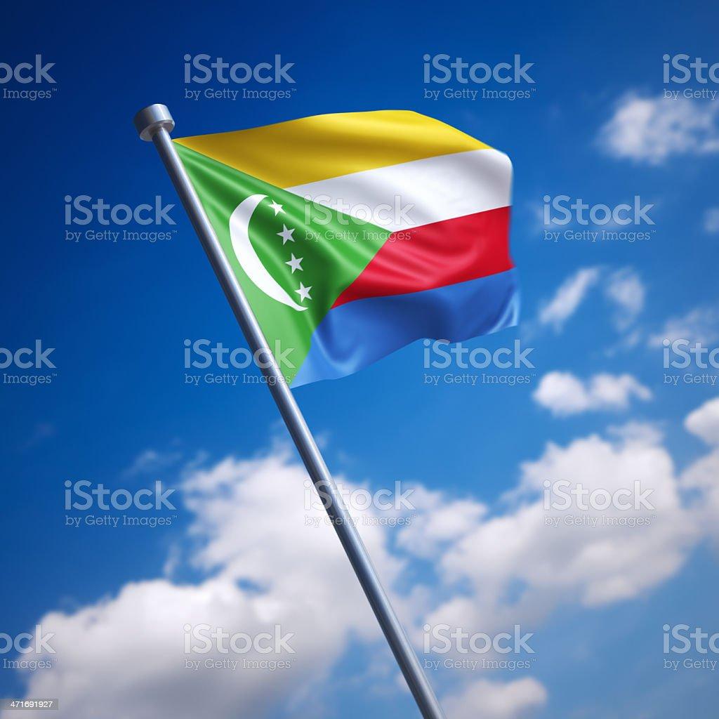 Flag of Comoros against blue sky stock photo