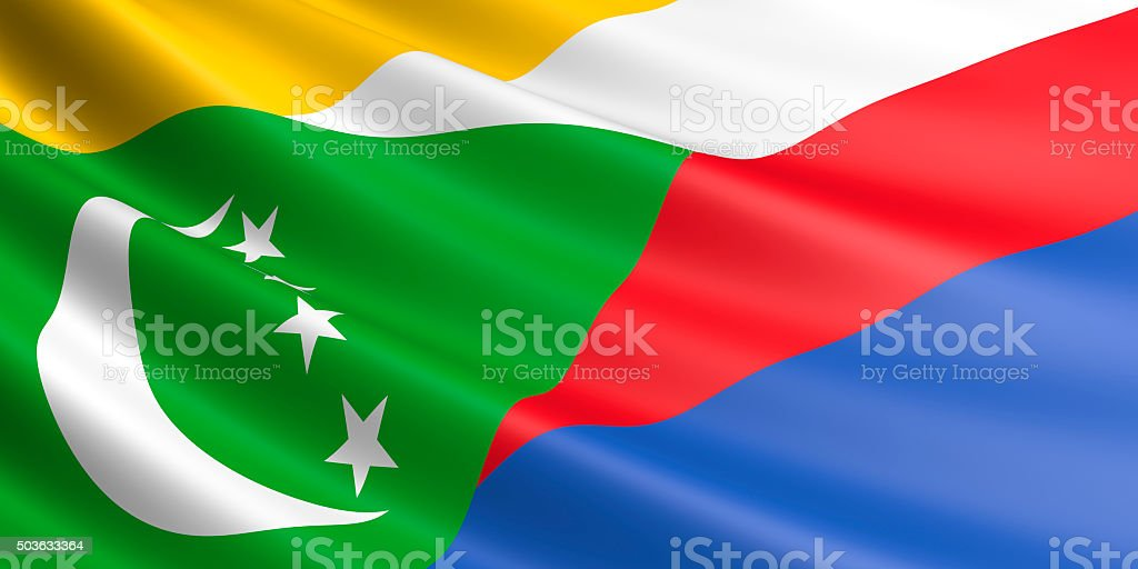Flag of Comoros waving in the wind. royalty-free stock photo