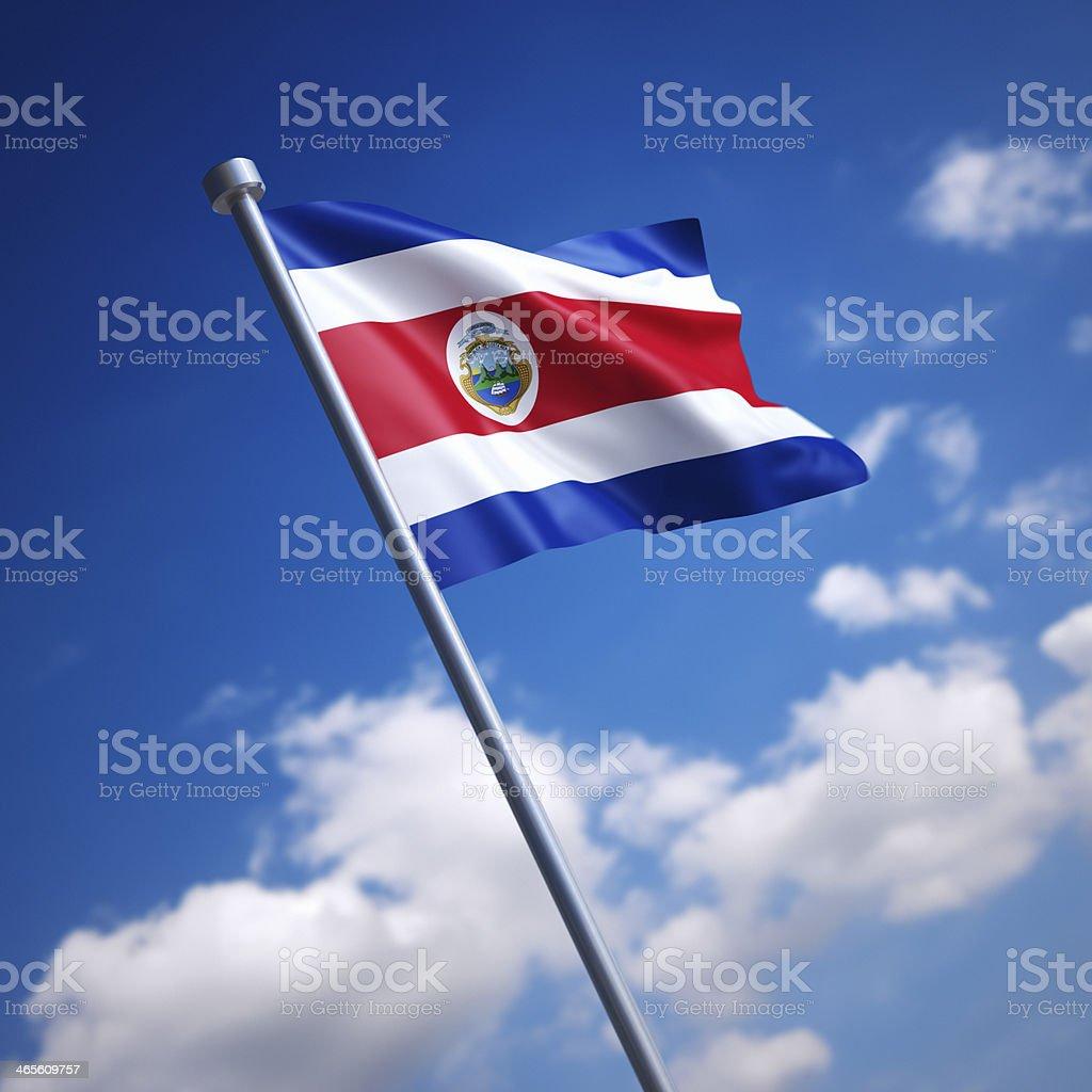 Flag of Costa Rica against blue sky stock photo