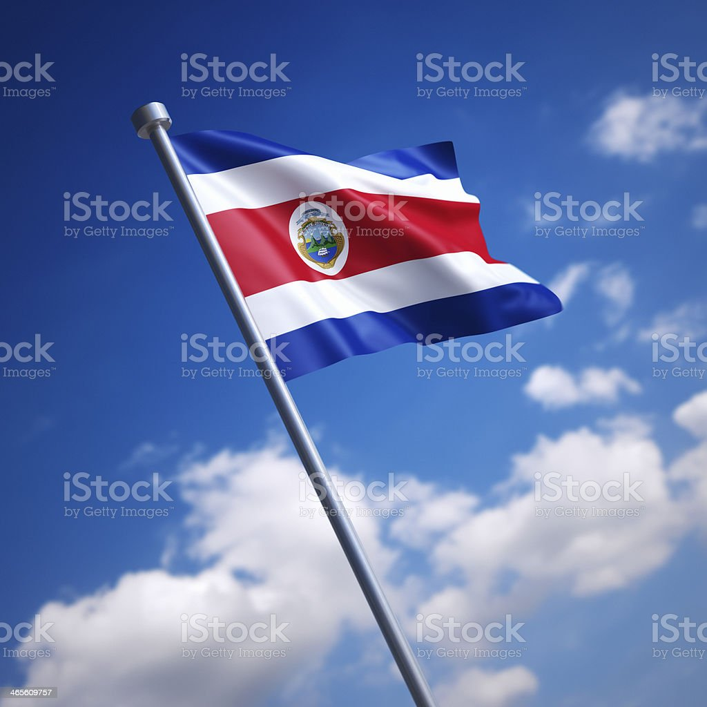 Flag of Costa Rica against blue sky stock photo