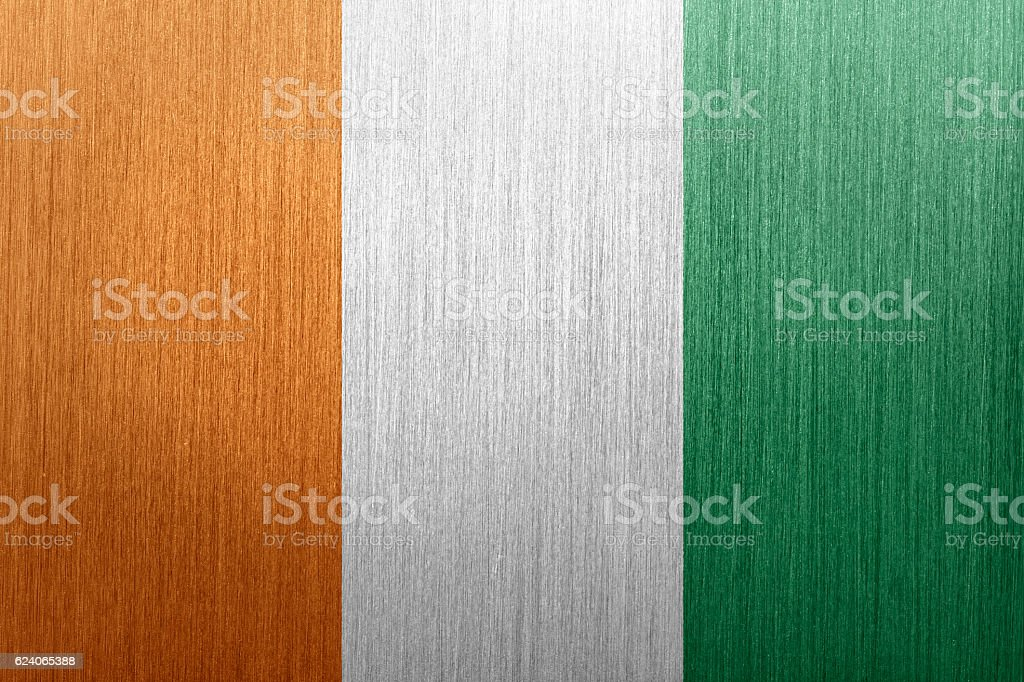 Flag of Cote D'Ivoire on a brushed metal background stock photo