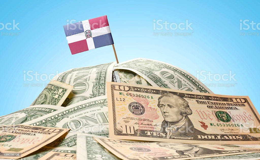 Flag of Dominican Republic sticking in american banknotes.(serie stock photo
