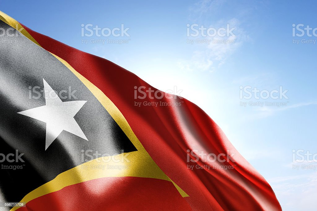 Flag of East Timor waving in the wind stock photo