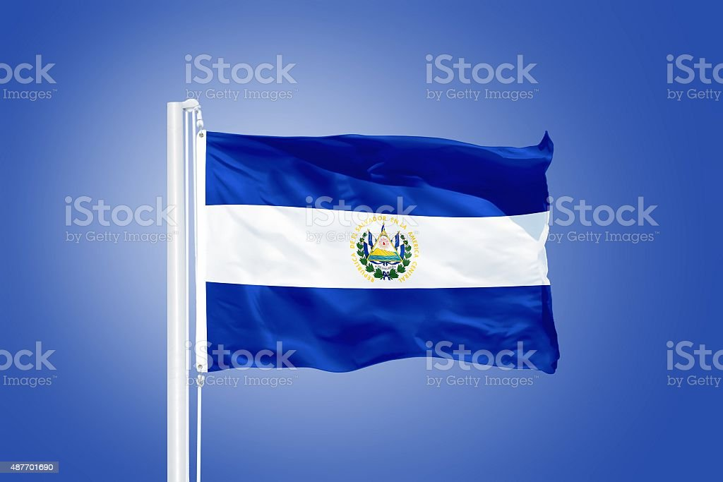 Flag of El Salvador flying against a blue sky stock photo