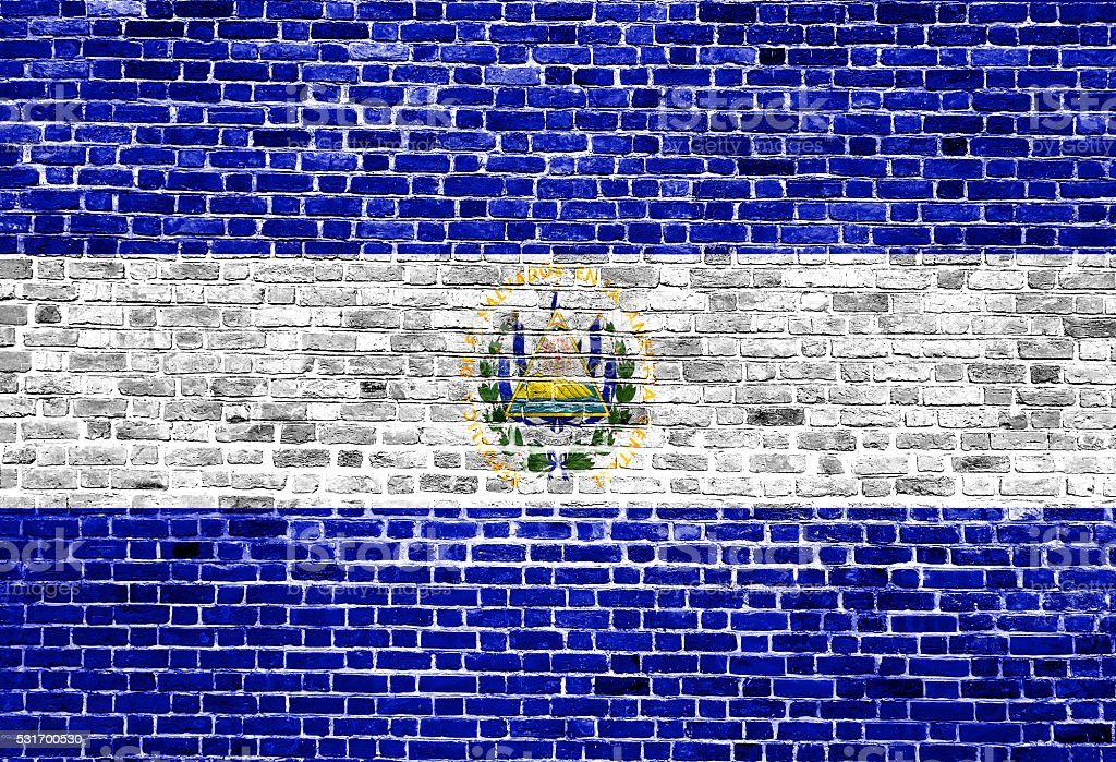 Flag of El Salvador painted on brick wall, background texture stock photo