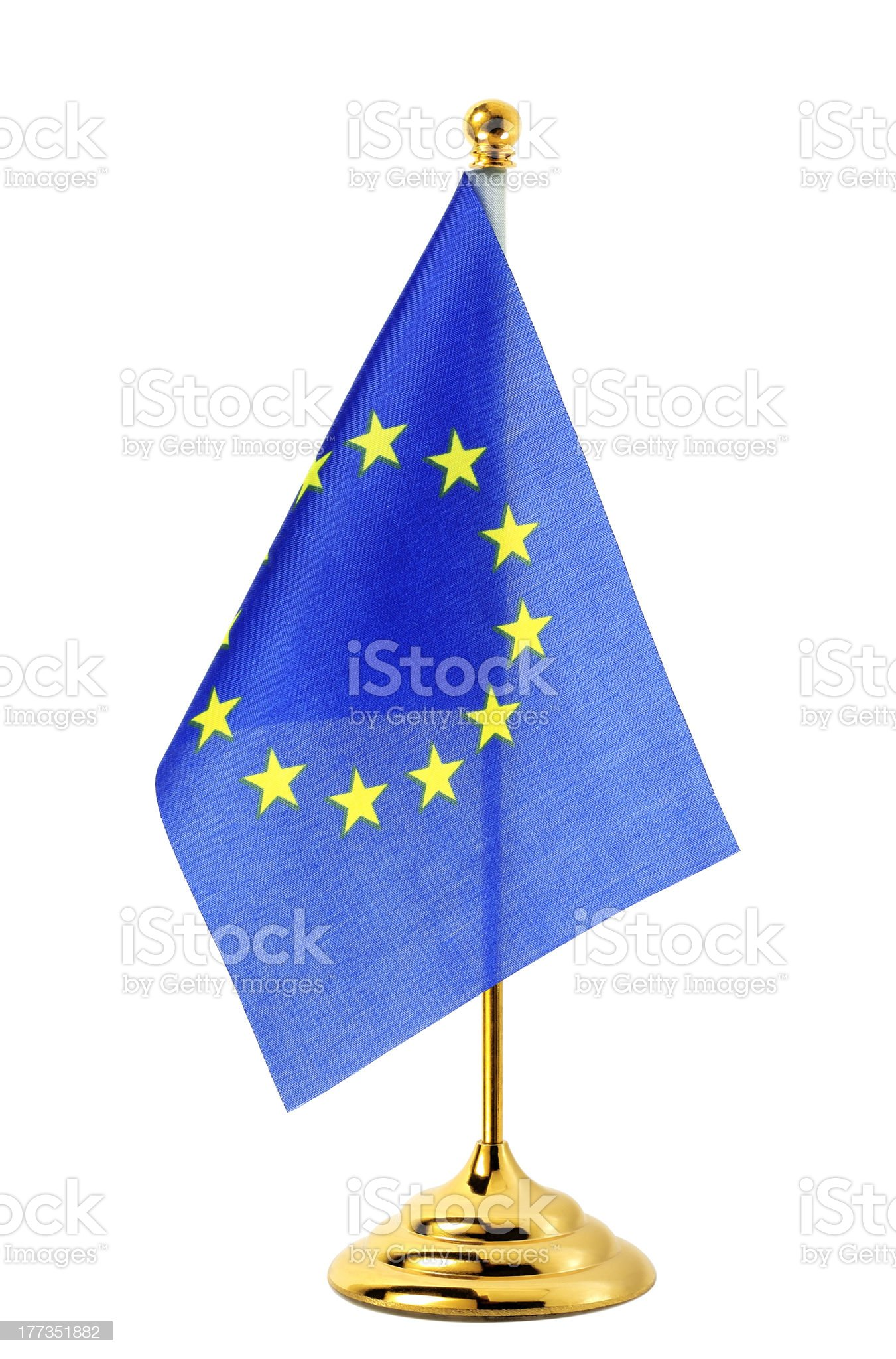Flag of EU hanging on the gold flagpole royalty-free stock photo