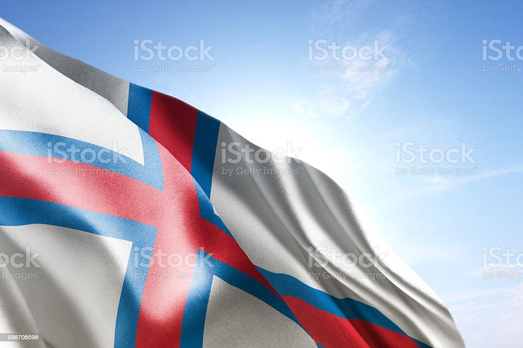 Flag of Faroe Islands waving in the wind stock photo