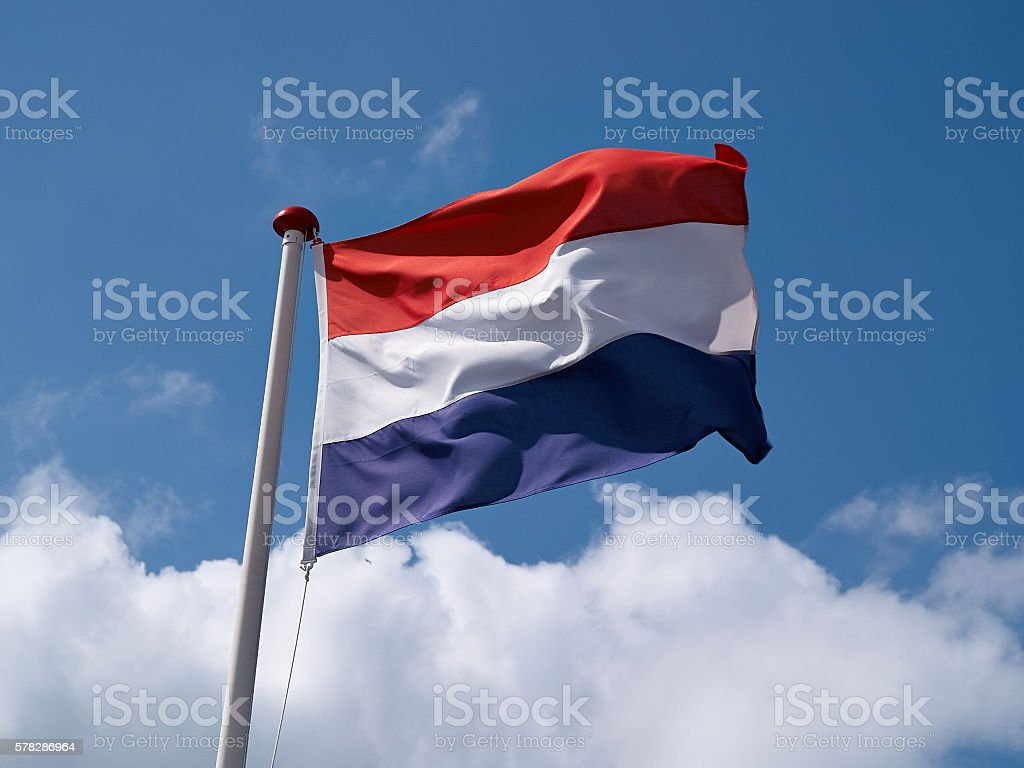 Flag of France against blue cloudy sky stock photo