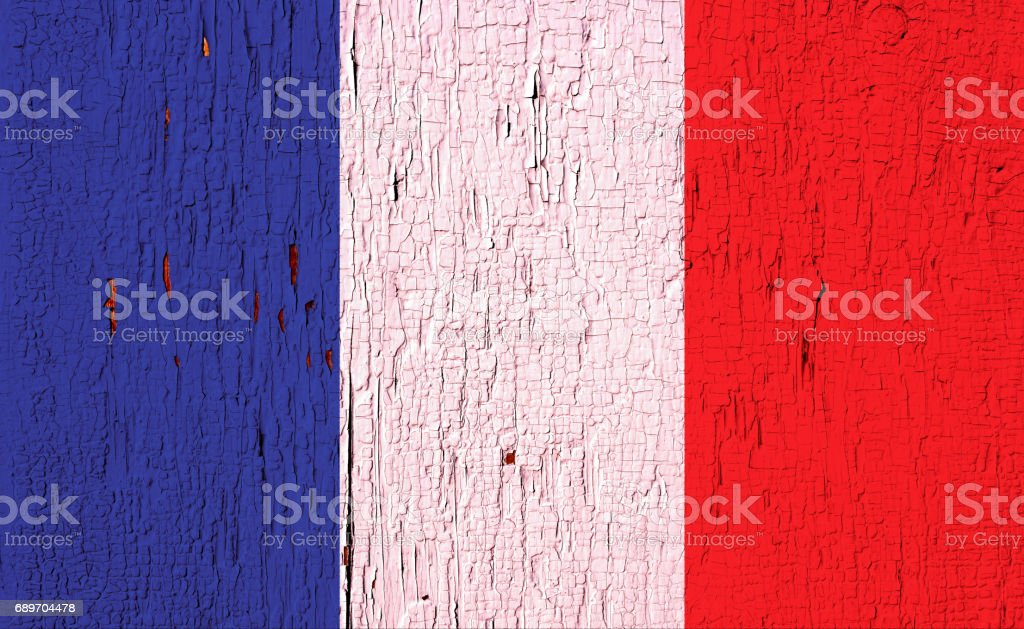 Flag of France on the peeled, textured, aged paint surface stock photo