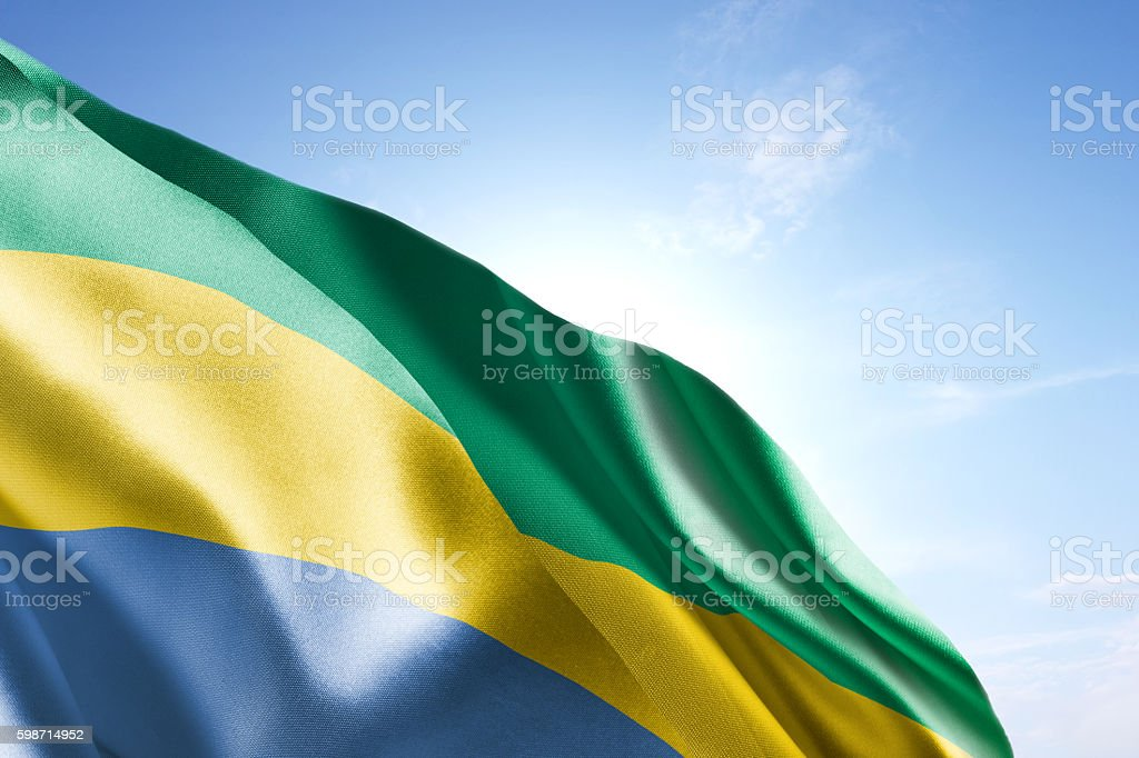 Flag of Gabon waving in the wind stock photo