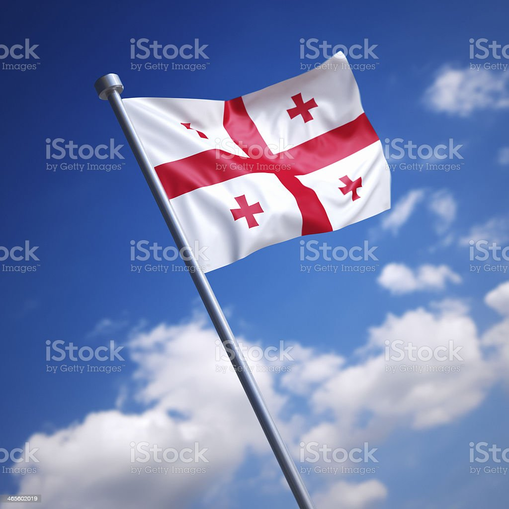 Flag of Georgia against blue sky stock photo