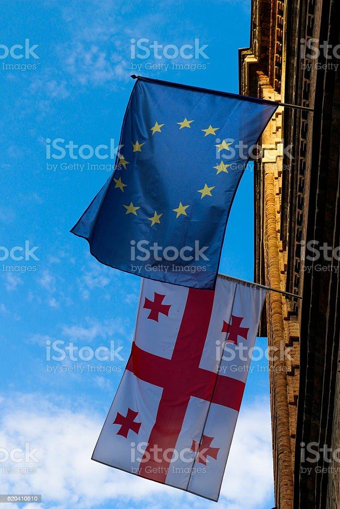 Flag of Georgia and  the european union on a wall stock photo
