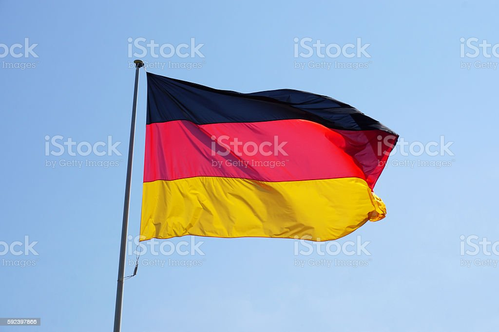 Flag of Germany against clear sky stock photo