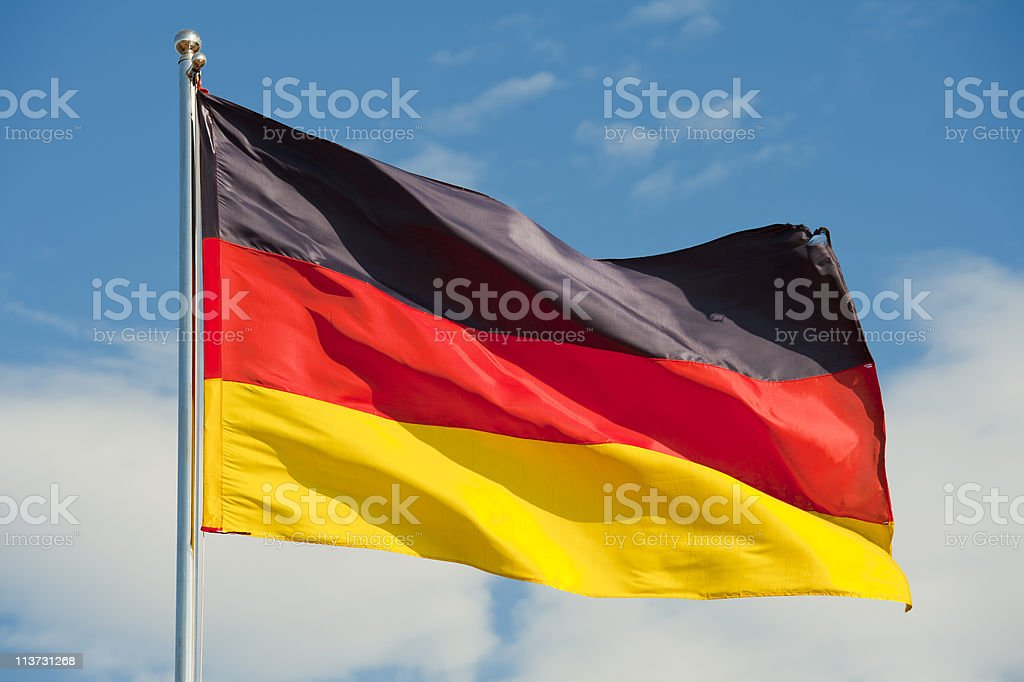 Flag of Germany flying on top of flag pole stock photo
