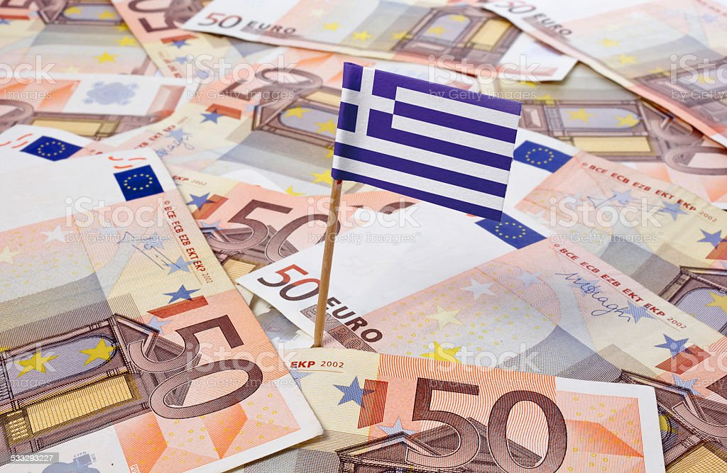 Flag of Greece sticking in 50 Euro banknotes.(series) stock photo