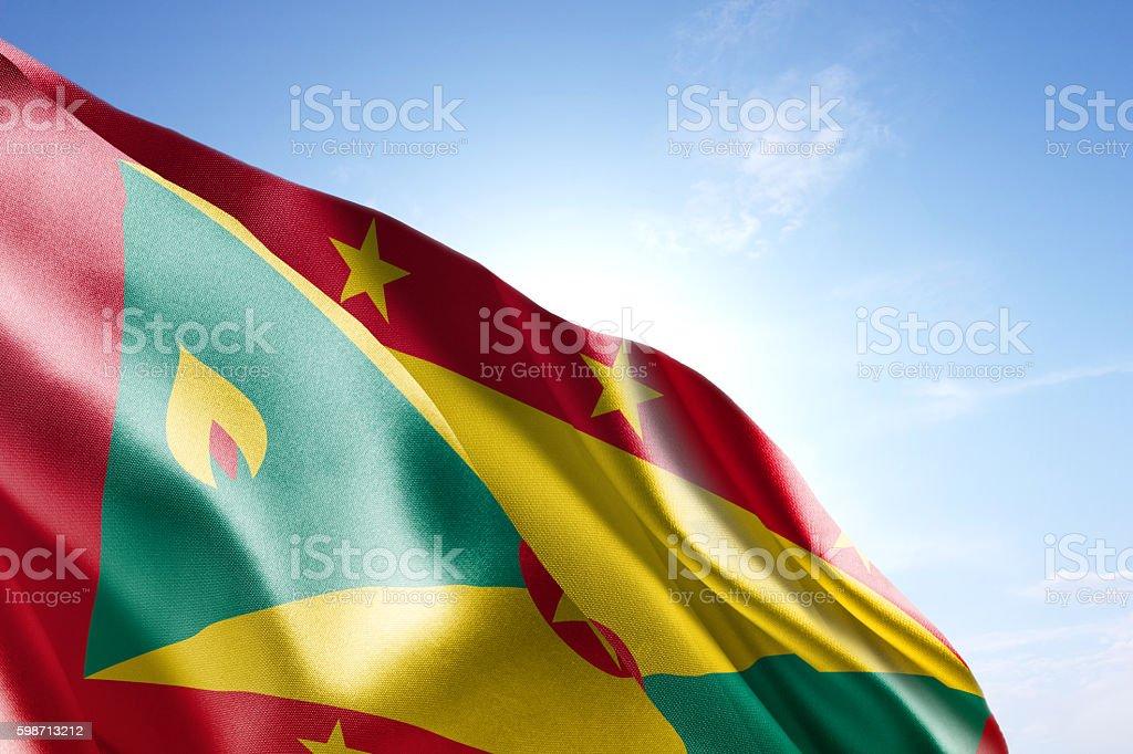 Flag of Grenada waving in the wind stock photo