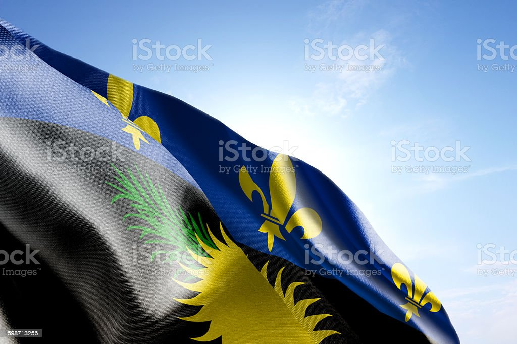 Flag of Guadeloupe waving in the wind stock photo