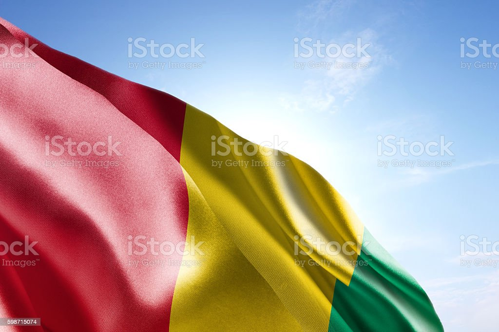 Flag of Guinea waving in the wind stock photo