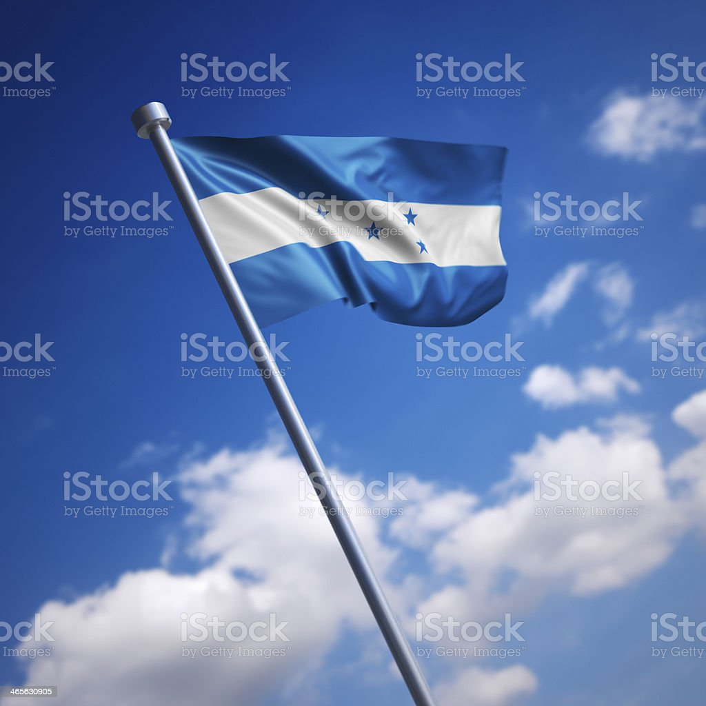 Flag of Honduras against blue sky stock photo