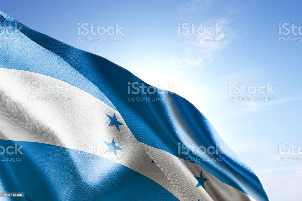 Flag of Honduras waving in the wind stock photo