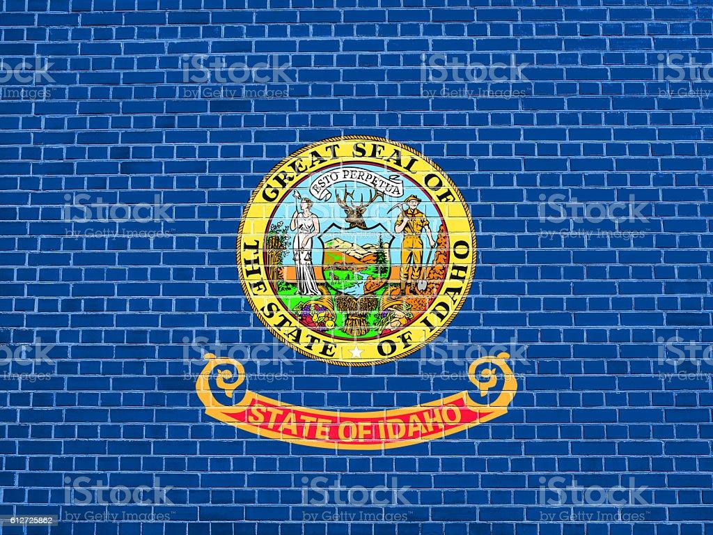 Flag of Idaho on brick wall texture background stock photo