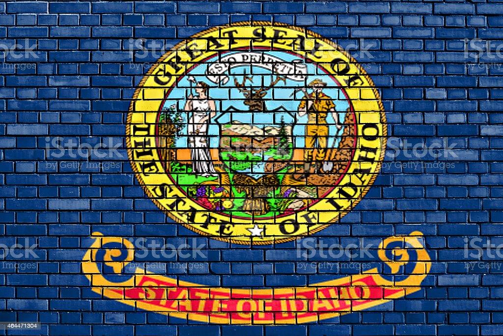 flag of Idaho painted on brick wall stock photo