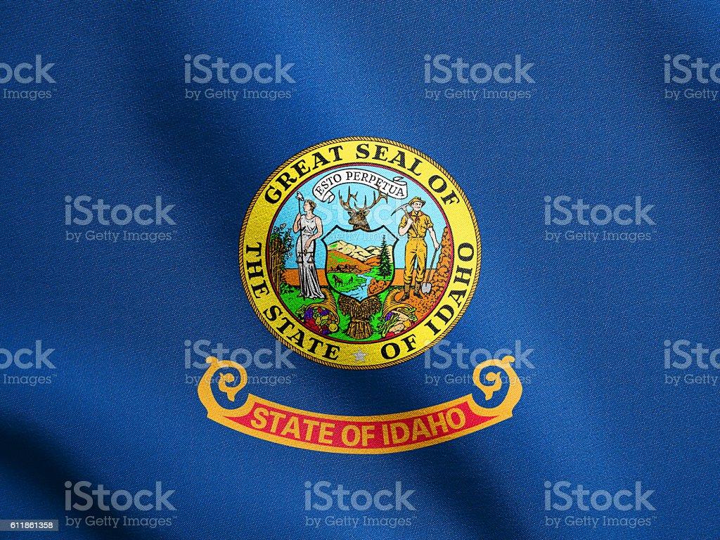 Flag of Idaho waving with fabric texture stock photo