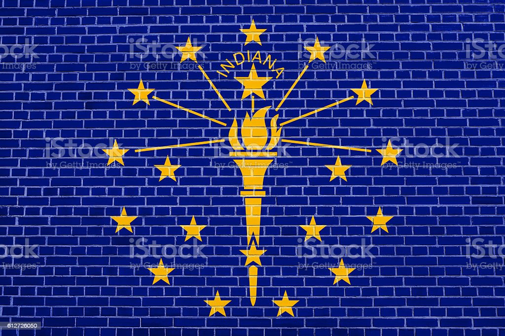 Flag of Indiana on brick wall texture background stock photo