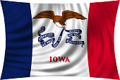 Flag of Iowa waving isolated on white