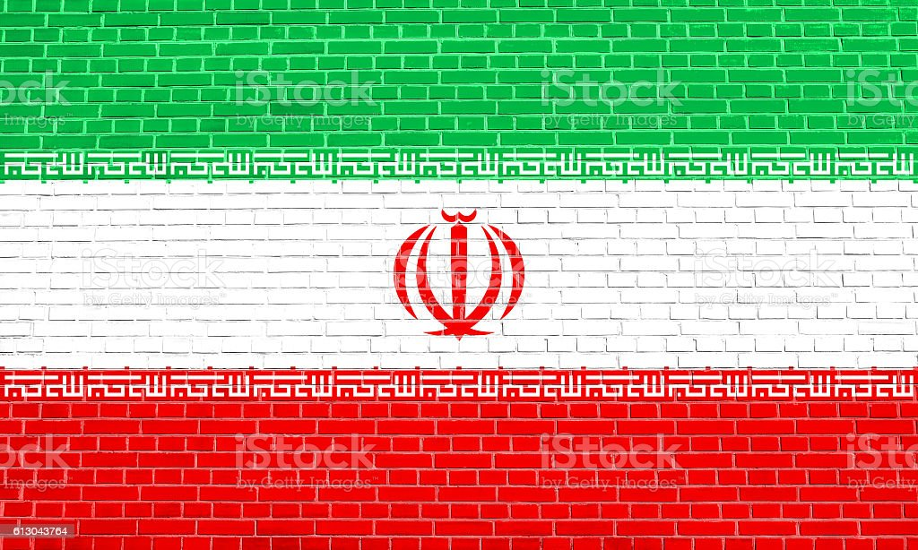 Flag of Iran on brick wall texture background stock photo