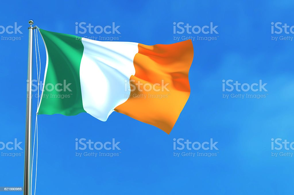 Flag of Ireland on the blue sky background. stock photo