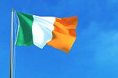 Flag of Ireland on the blue sky background.