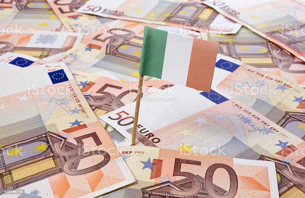 Flag of Ireland sticking in 50 Euro banknotes.(series) stock photo