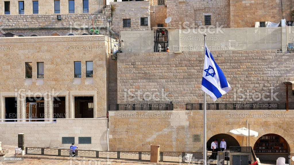 Flag of Israel is waving and flying on the wind stock photo