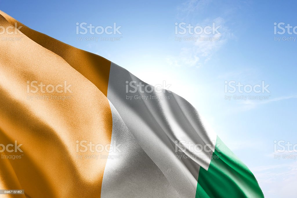 Flag of Ivory Coast waving in the wind stock photo