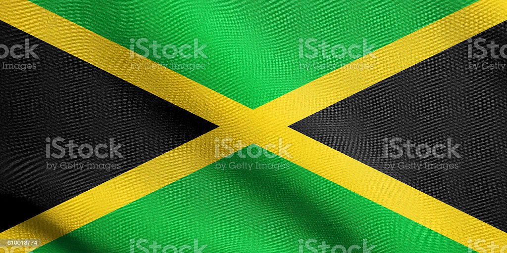 Flag of Jamaica waving with fabric texture stock photo