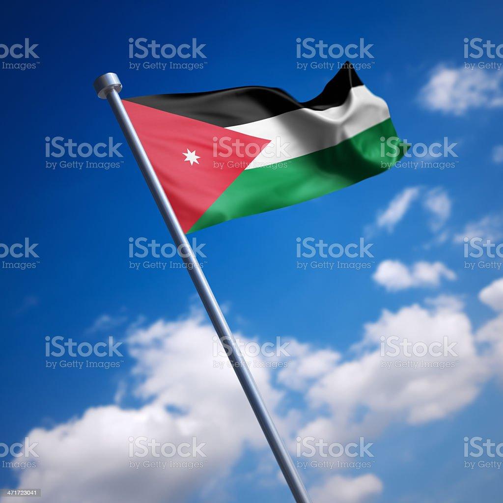 Flag of Jordan against blue sky stock photo