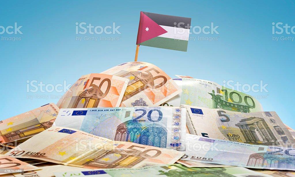 Flag of Jordan sticking in european banknotes.(series) stock photo
