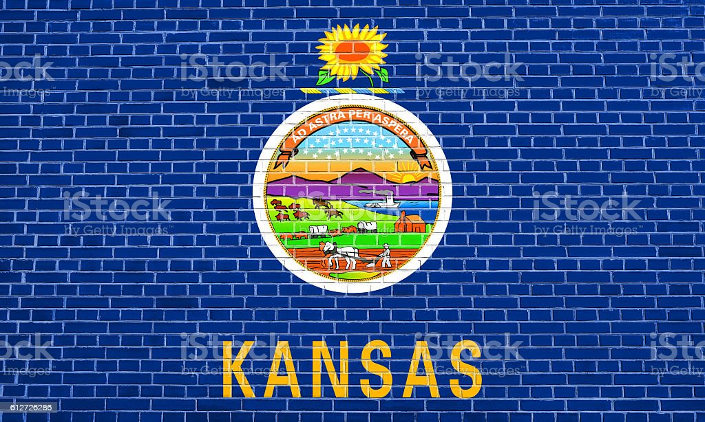 Flag of Kansas on brick wall texture background stock photo