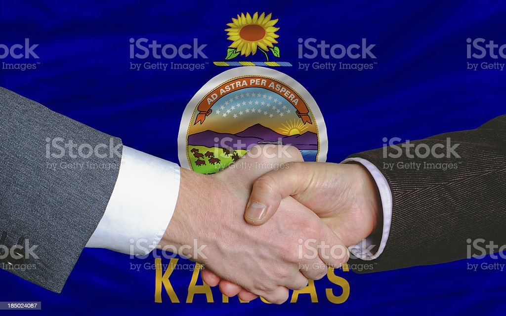 flag of kansas two businessmen handshake stock photo