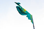 Flag of Kazakhstan on the blue sky background