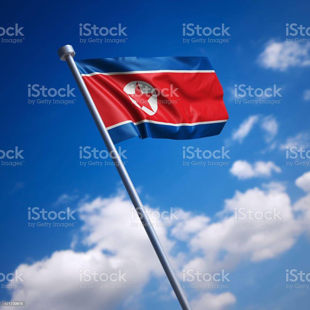 Flag of Korea, North - against blue sky stock photo